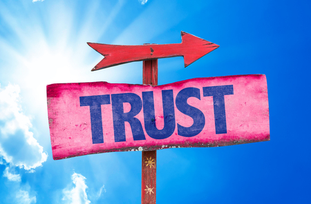 believing: Trust sign with arrow on sunny background