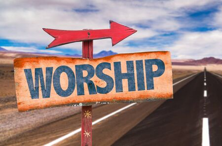 glorification: Worship sign with arrow on a highway background Stock Photo