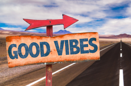 vibes: Good Vibes sign with arrow on a highway background