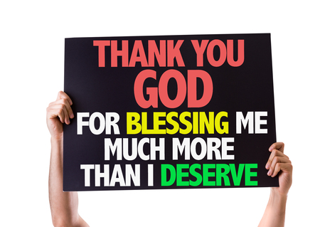 blessing: Hands holding blackboard with Thank You God For Blessing Me Much More Than I Deserve on white background