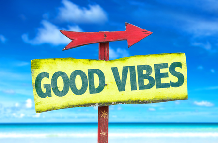 vibes: Good Vibes sign with arrow on beach background