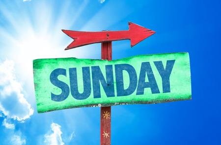 Sunday sign with arrow on sunny background