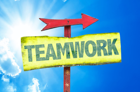 common goals: Teamwork sign with arrow on sunny background Stock Photo