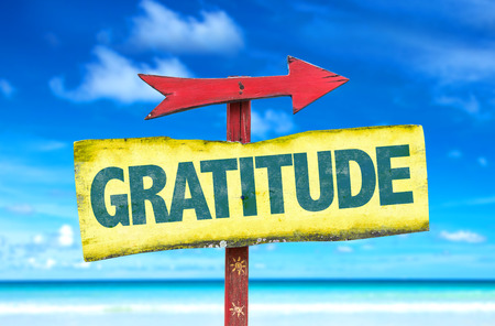 thankfulness: Gratitude sign with arrow on beach background