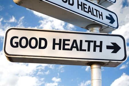 good health: Good Health sign with clouds and sky background