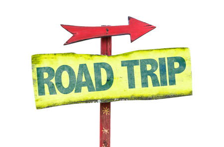 Road Trip sign with arrow on white background