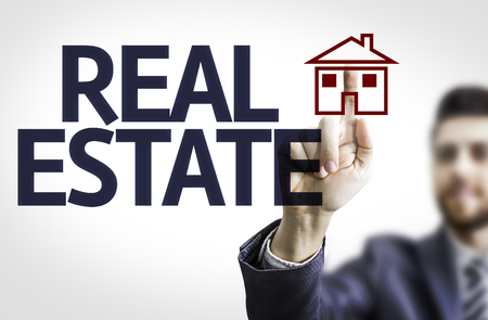 advertise: Business man pointing to transparent board with text: Real Estate
