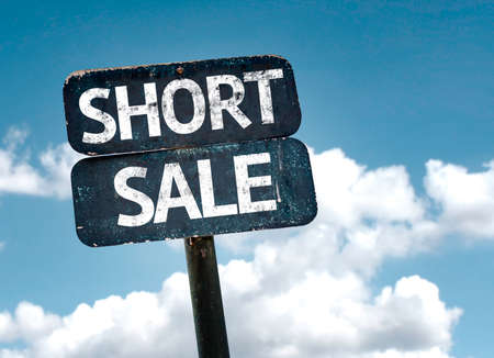short sale: Short Sale sign with clouds and sky background