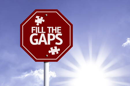 gaps: Fill The Gaps written on the road sign Stock Photo