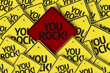 Een rode verkeersbord onder meerdere borden met de tekst: You Rock