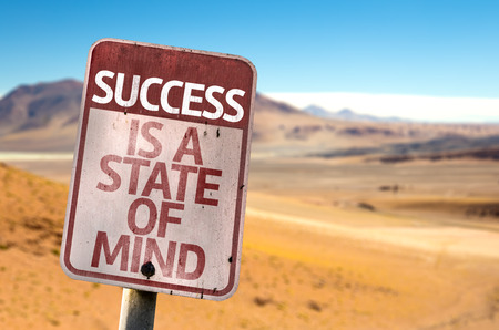 success word: Success Is A State Of Mind sign with desert background