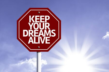 alive: Keep Your Dreams Alive written on the road sign Stock Photo
