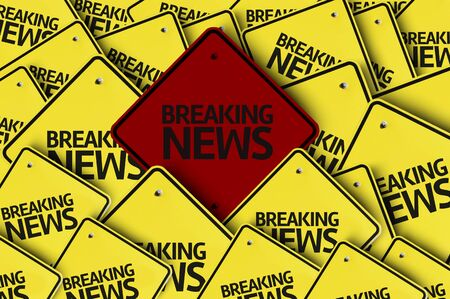 A red road sign amongst multiple road signs with text: Breaking News