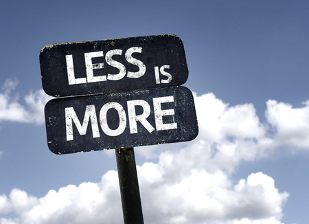less: Less Is More sign with clouds and sky background Stock Photo