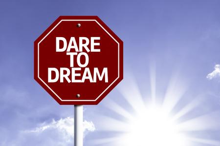 dare: Dare To Dream written on the road sign Stock Photo