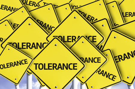 tolerate: Multiple road signs with text: Tolerance Stock Photo