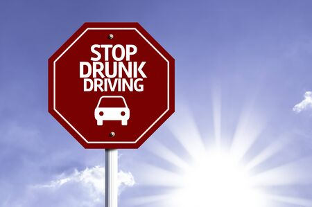 endanger: Stop Drunk Driving written on the road sign Stock Photo