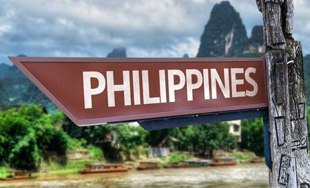 pinoy: Wooden sign board in wetland with text: Philippines Stock Photo