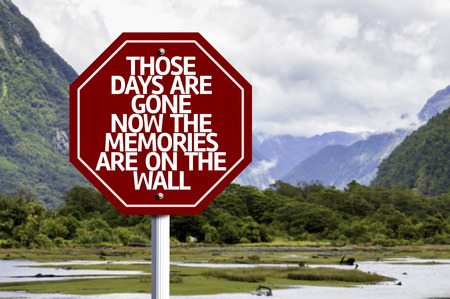 those: Those Days Are Gone Now The Memories Are On The Wall written on the road sign with valley background Stock Photo