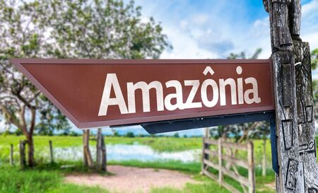 amazonia: Wooden sign board in park with text: Amazonia Stock Photo