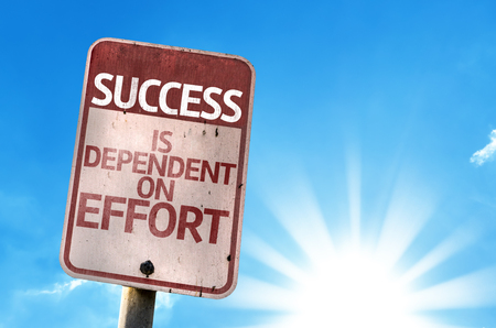 sacrifices: Success Is Dependent On Effort written on the road sign Stock Photo