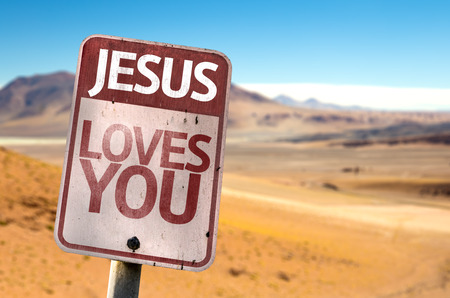 loves: Jesus Loves You sign with desert background Stock Photo