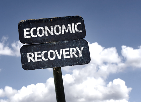 economic recovery: Economic Recovery sign with clouds and sky background