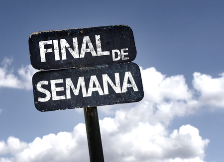 semana: End of Week in Spanish sign with clouds and sky background Stock Photo
