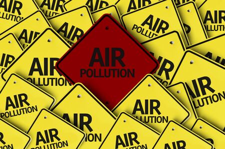 A red road sign amongst multiple road signs with text: Air Pollution