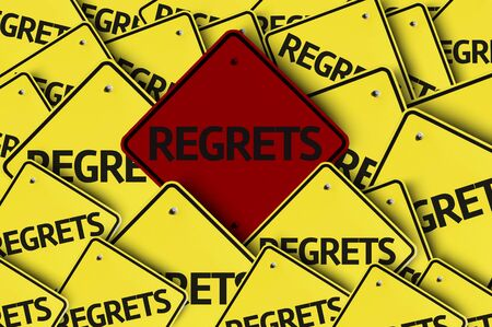 no mistake: A red road sign amongst multiple road signs with text: Regrets