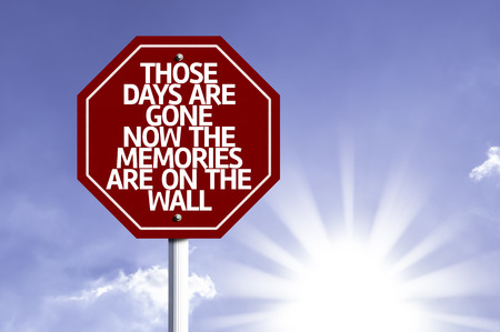 days gone by: Those Days Are Gone Now The Memories Are On The Wall written on the road sign Stock Photo