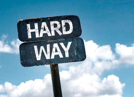 hard way: Hard Way sign with clouds and sky background