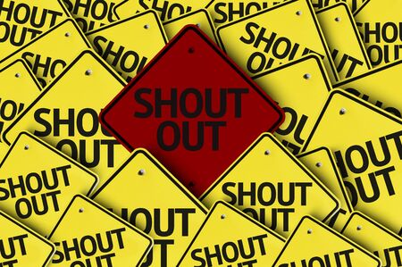 A red road sign amongst multiple road signs with text: Shout Out