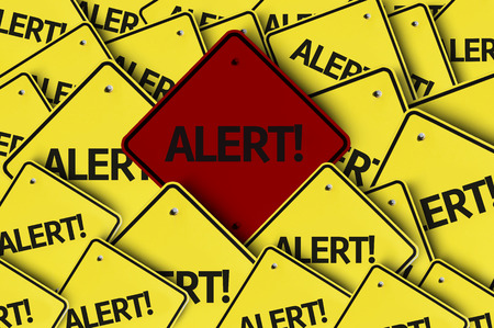 be alert: A red road sign amongst multiple road signs with text: Alert!