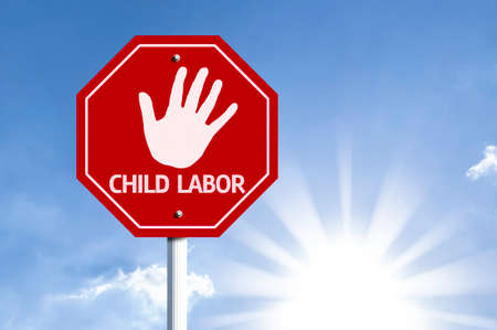 forced: Child Labor written on the road sign Stock Photo