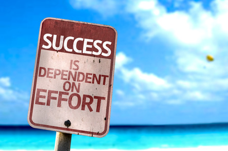 dependent: Success Is Dependent On Effort sign with sea background