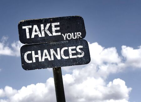 chances: Take Your Chances sign with clouds and sky background