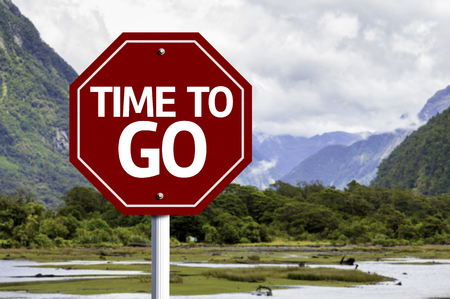 end times: Time To Go written on the road sign with valley background