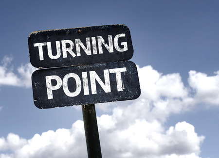 Turning Point sign with clouds and sky background