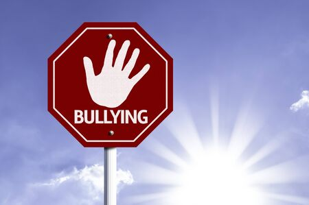 anti social: Bullying written on the road sign Stock Photo