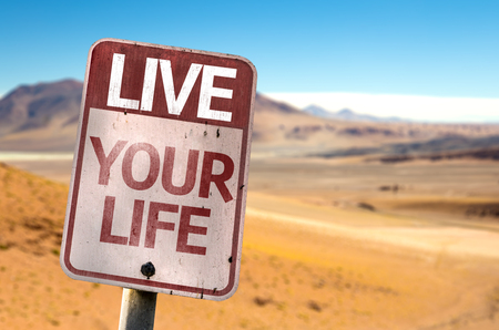 living wisdom: Live Your Life sign with desert background