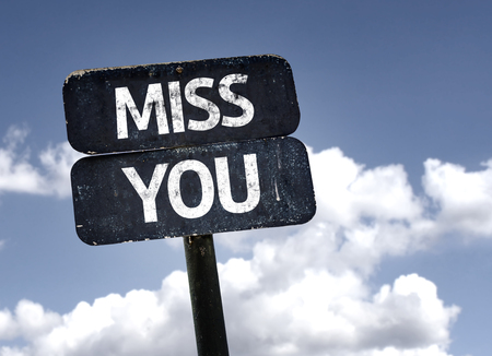 miss you: Miss You sign with clouds and sky background