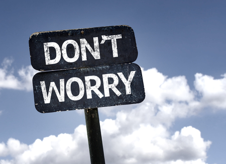 dont worry: Dont Worry sign with clouds and sky background