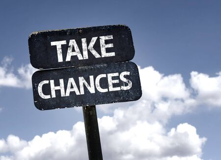 chances: Take Chances sign with clouds and sky background Stock Photo