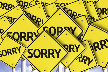 apologetic: Multiple road signs with text: Sorry