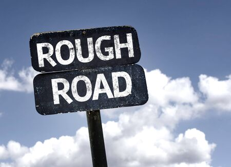 rough road: Rough Road sign with clouds and sky background Stock Photo