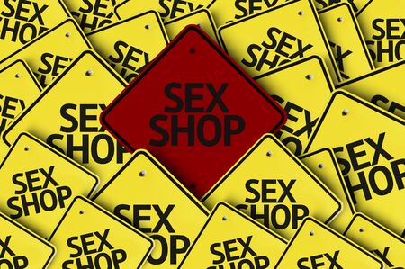 sex shop: A red road sign amongst multiple road signs with text: Sex Shop