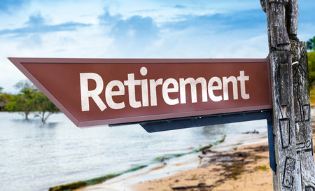 retiring: Wooden sign board in wetland with text: Retirement Stock Photo