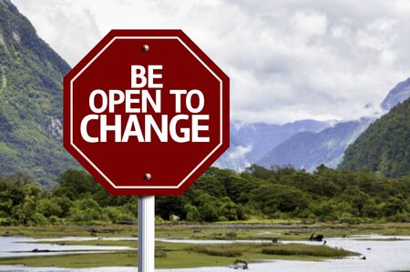 be the change: Be Open to Change written on the road sign with valley background