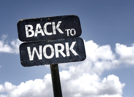 Back To Work sign with clouds and sky background Foto de archivo
